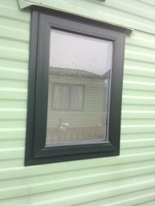 static caravan window in green