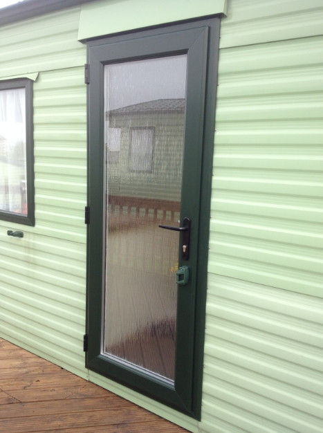 green static caravan door in lancashire
