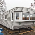 External vinyl cladding for static caravans